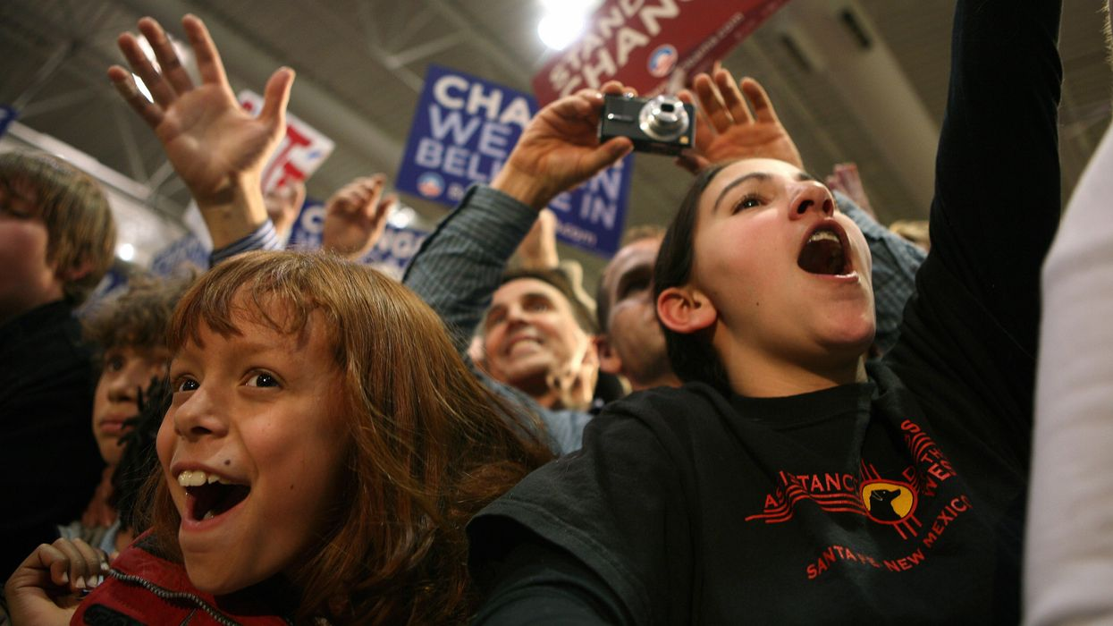 Young people cheering for the Democrats during an election.
