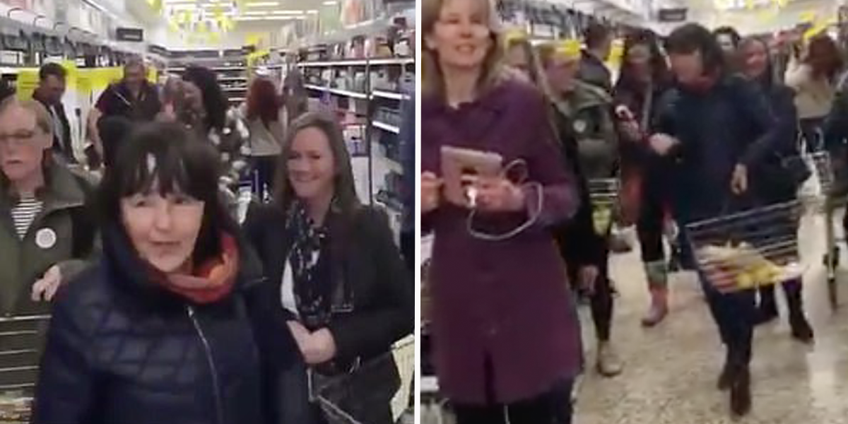 Dozens of Maskless Conspiracy Theorists Storm Into Grocery Store for Anti-Mask Protest