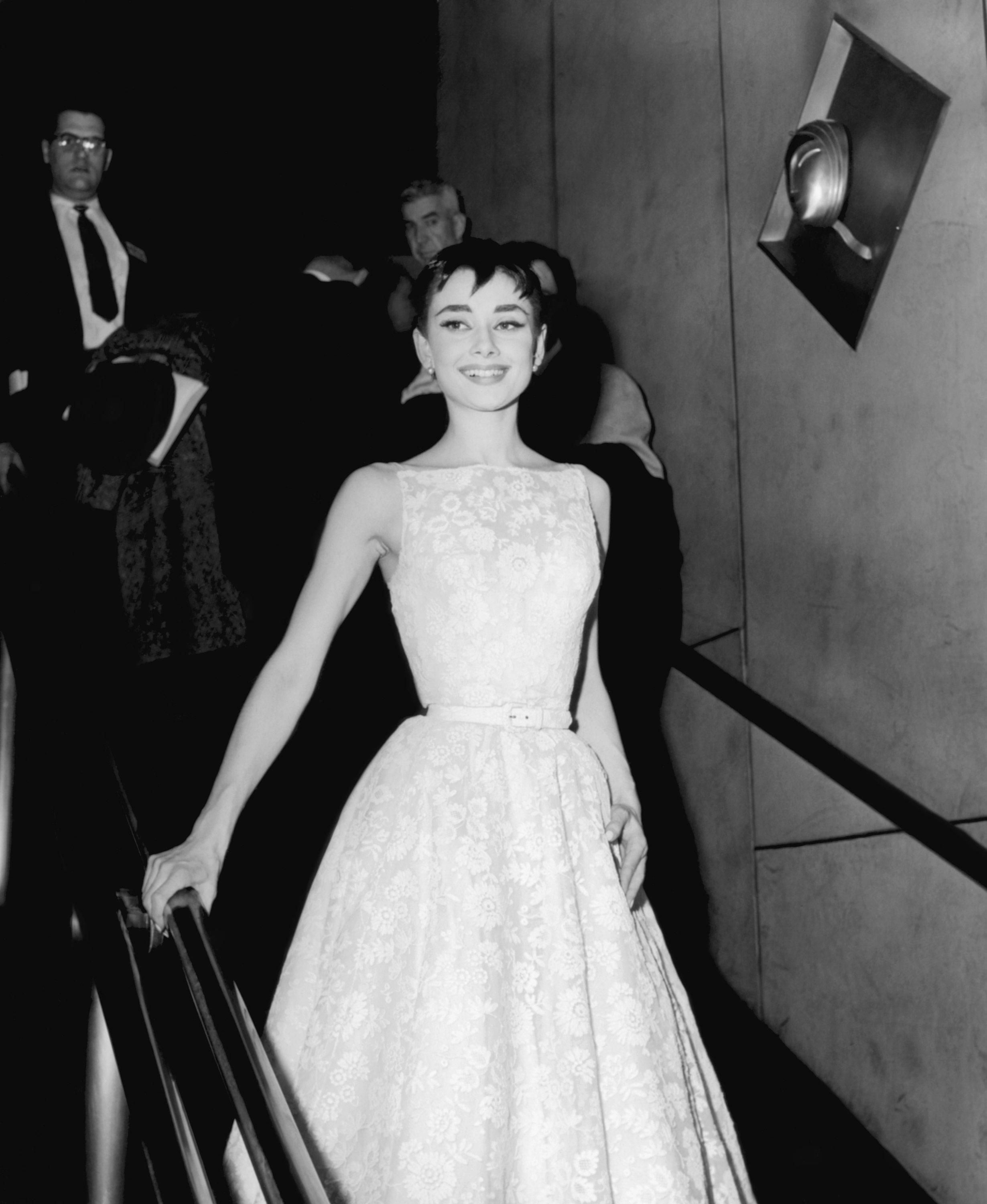 Audrey Hepburn in a white floral Givenchy dress at the Oscars in 1954