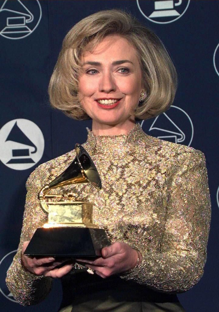 Hillary Clinton holding her GRAMMY