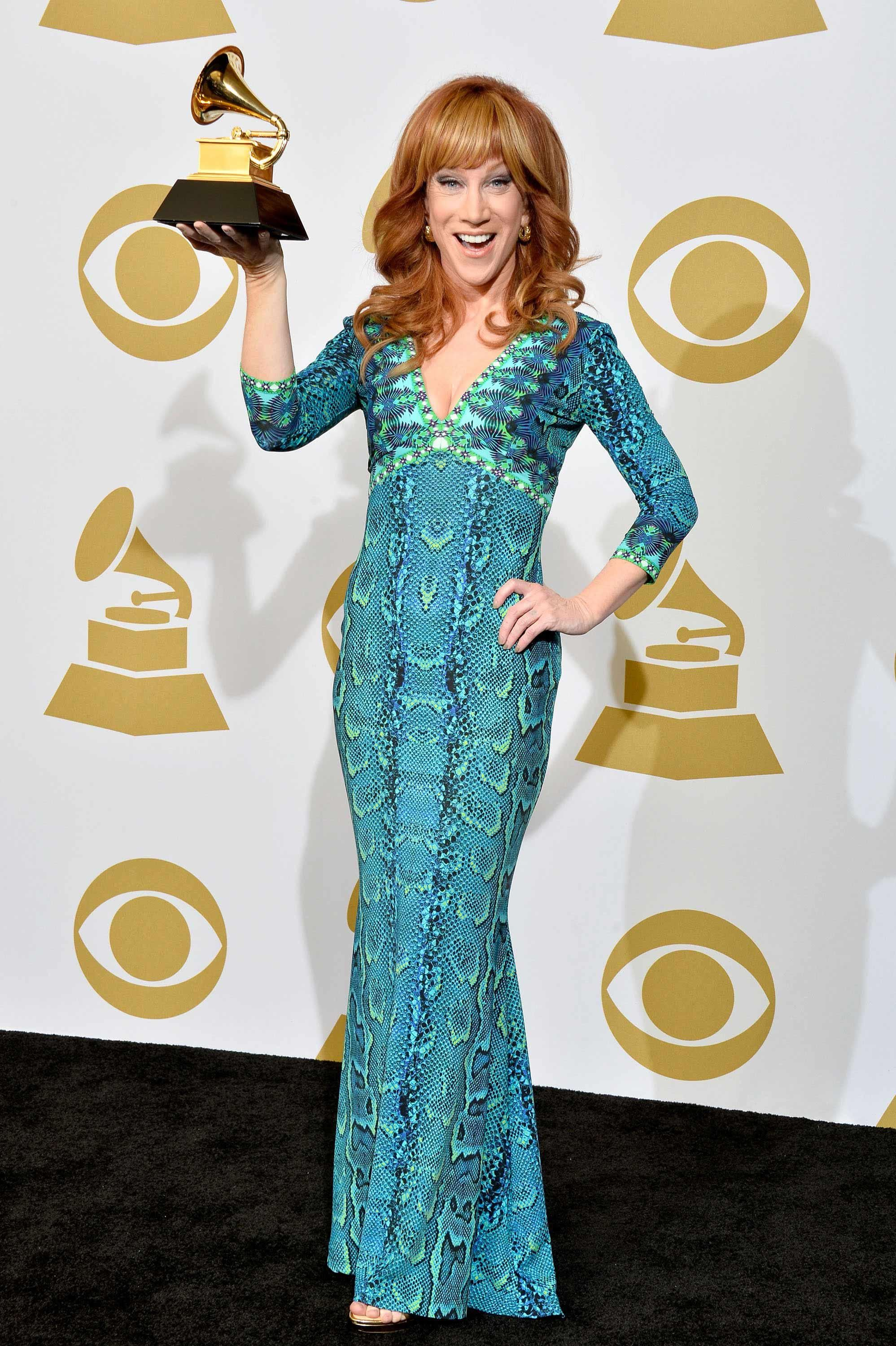 Kathy Griffin holding up her GRAMMY