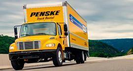 Penske truck driving on road