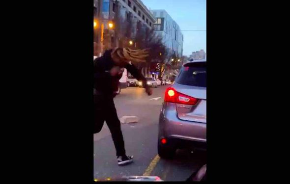VIDEO: Road rage perp physically attacks motorist on Philly street, chucks heavy debris at vehicle — and appears to grab a gun