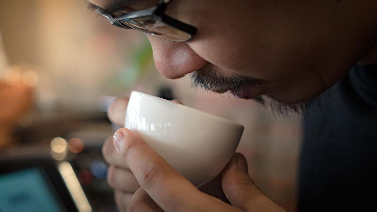 man sniffing coffee