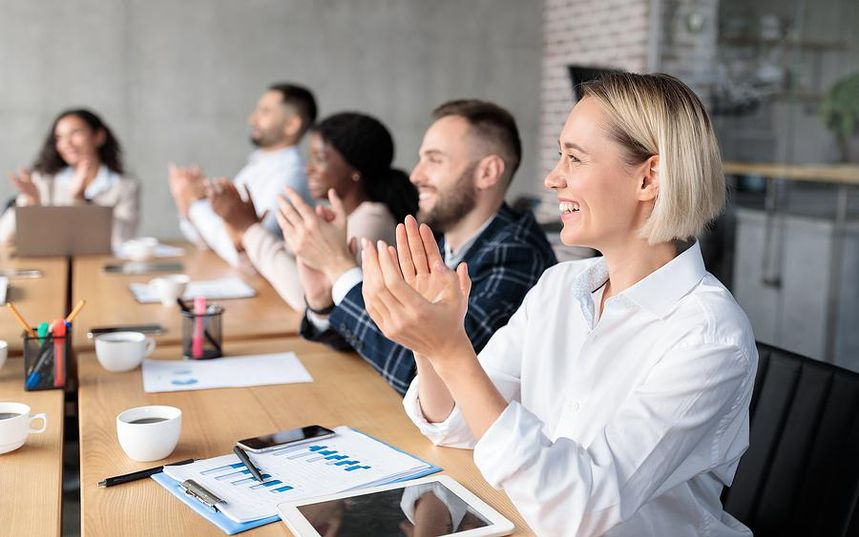 Successful woman claps after a presentation