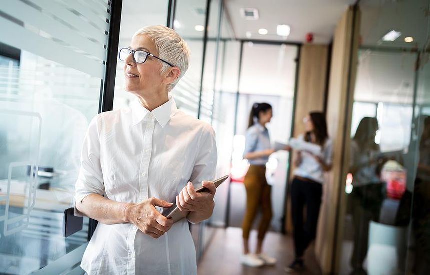 Older professional woman thinking about her career success