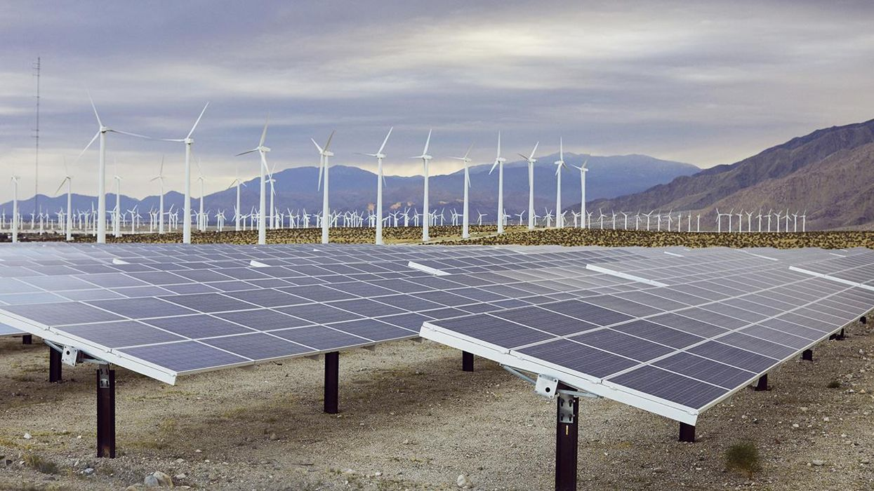solar panels and wind turbines in Texas field