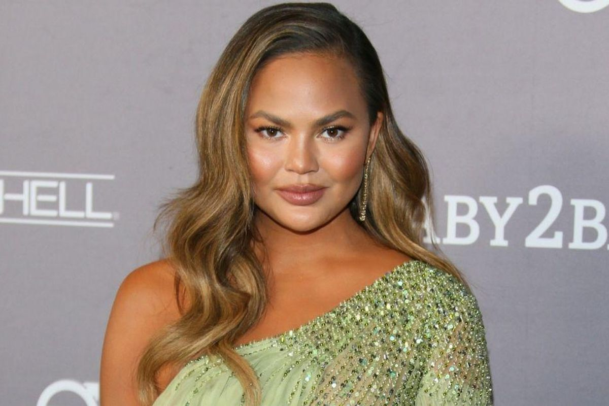 Chrissy Teigen Just Debuted Her New Silver 'Midlife Crisis' Hairdo—And Fans Are Rightly Obsessed