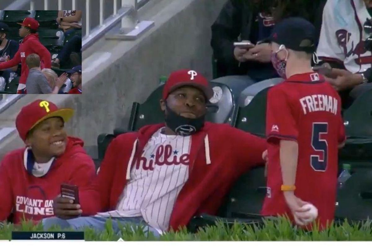 Young baseball fan goes viral after sweetly giving up home run ball to fan of rival team