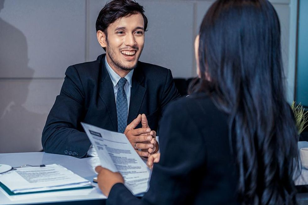 Man tries to beat the competition in a job interview