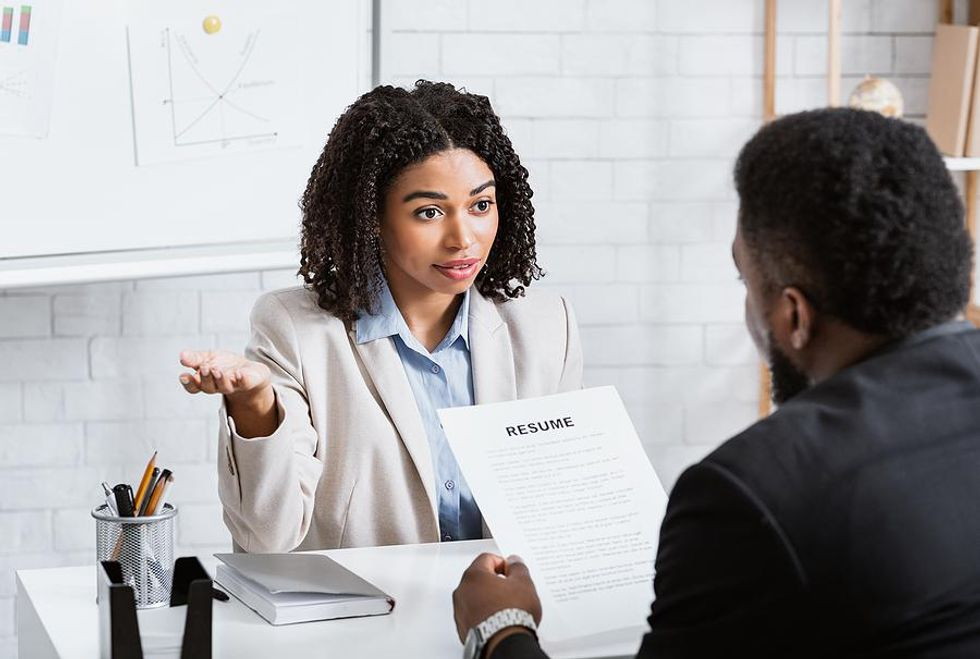 Woman tries to beat the competition in a job interview