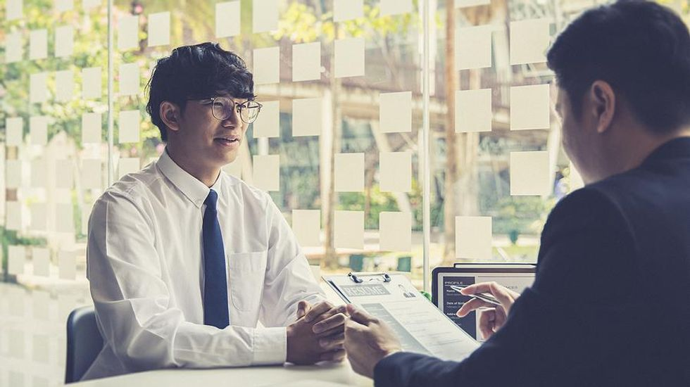 Man tries to stand out from the competition in a job interview