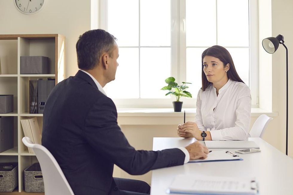 Woman tries to stand out from the competition in a job interview