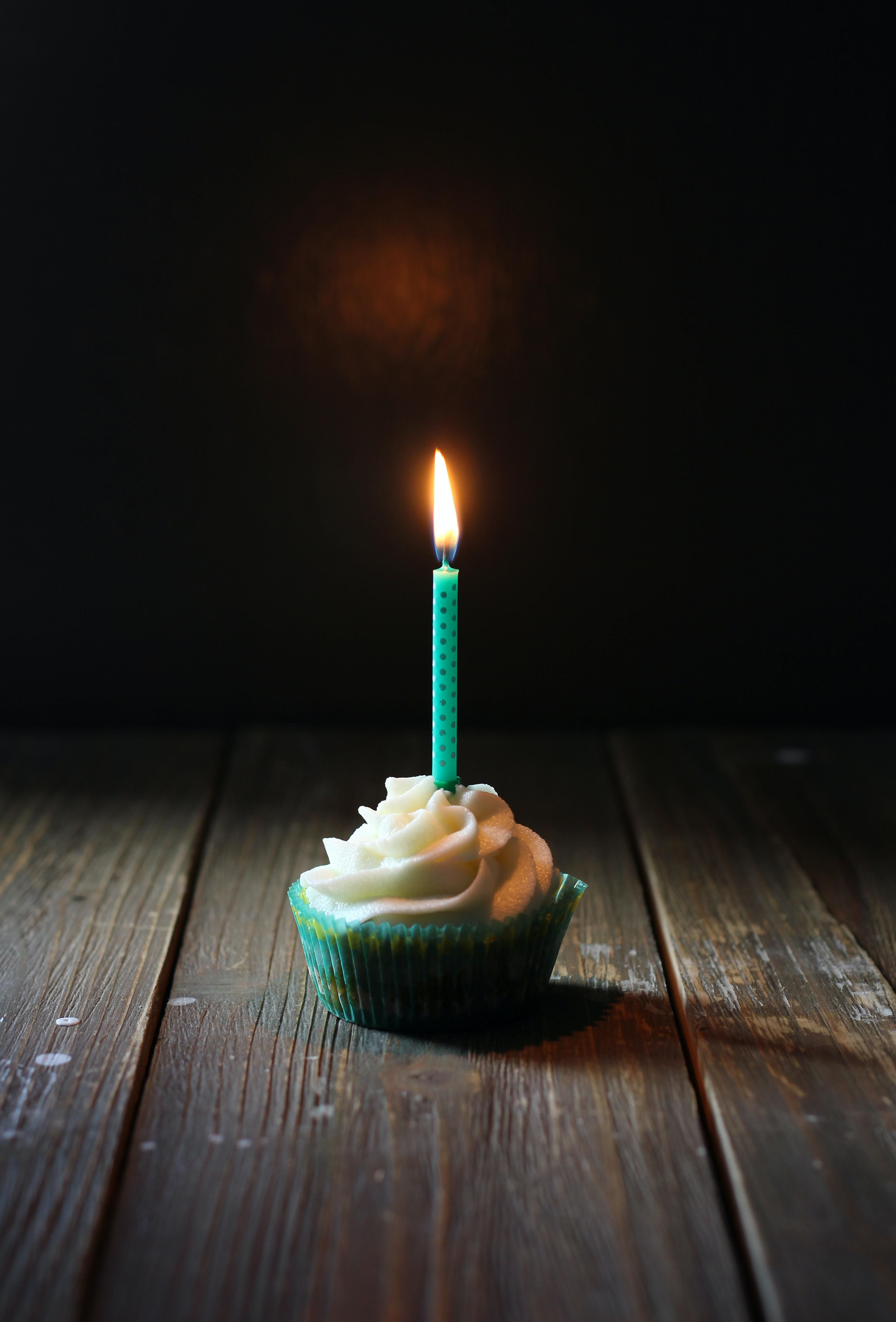one candle on cupcake