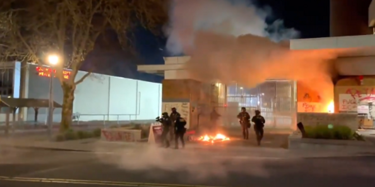 Portland rioters barricade door and set fire to ICE building with federal agents inside: 'Burn the precinct to the ground!'