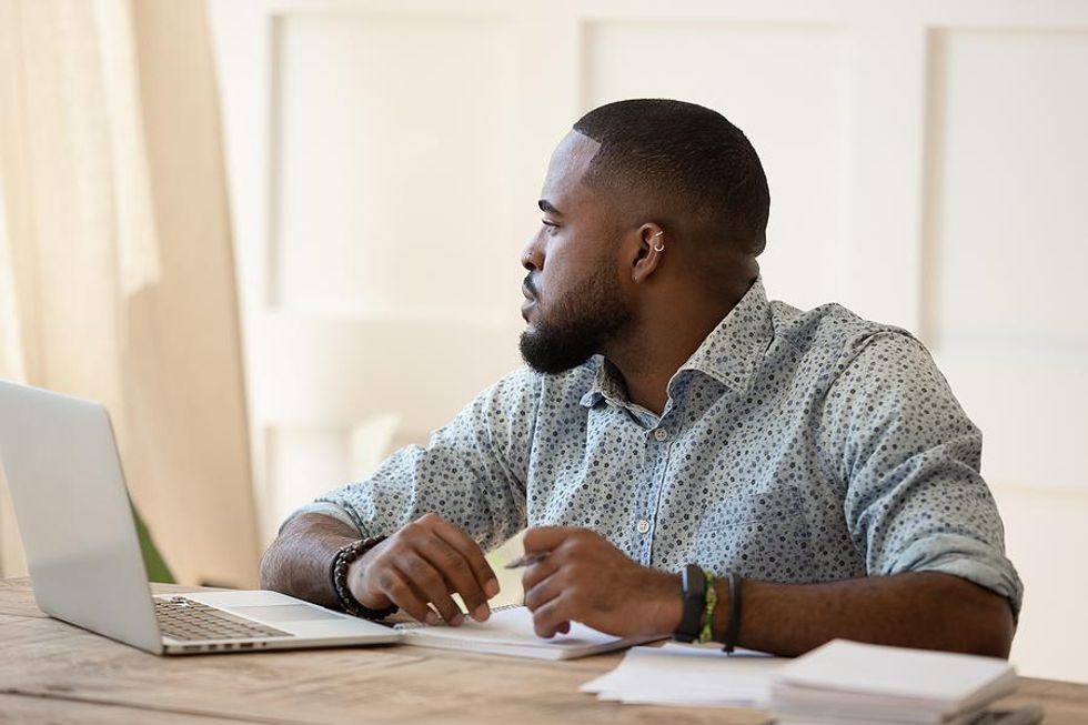 Man dreading work tries to work through his lack of motivation