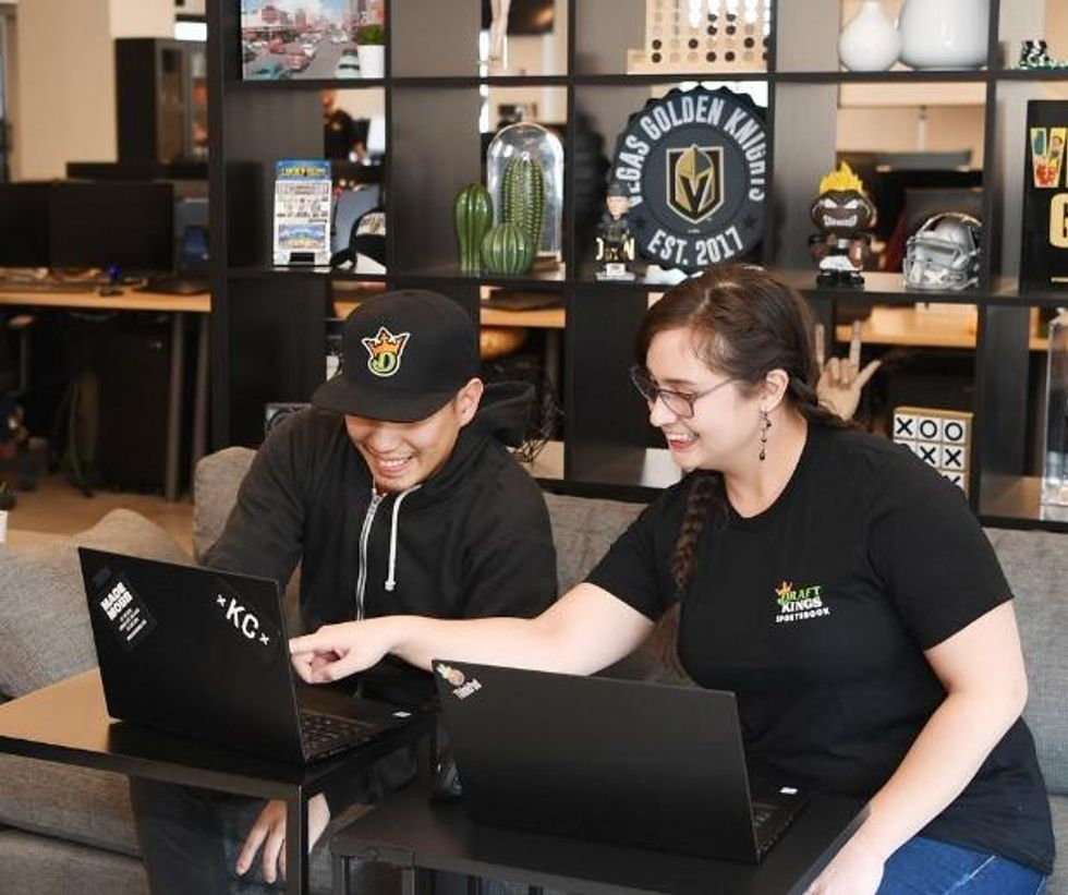 DraftKings employees collaborate at the company's Las Vegas office.
