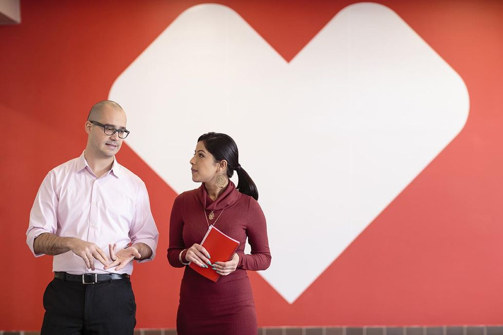 Coworkers chat at CVS Health offices.