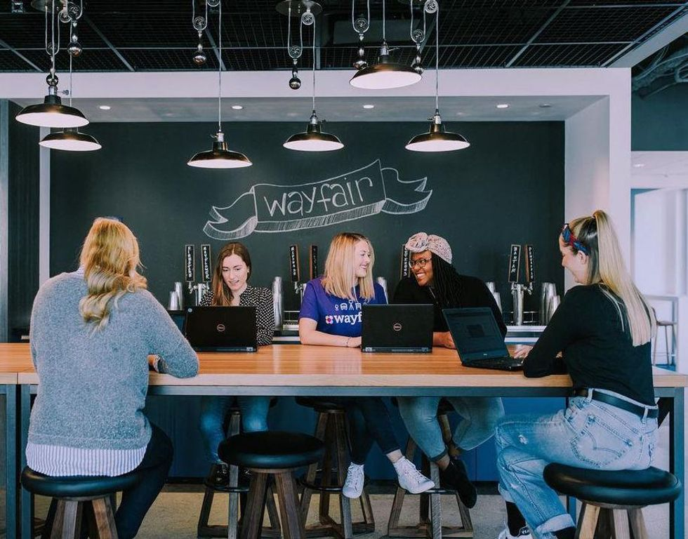 Wayfair employees collaborate at the company's headquarters.