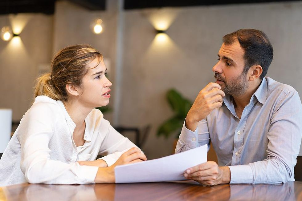 Woman discusses salary requirements with a hiring manager