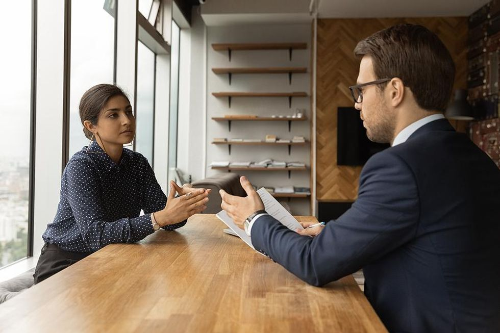 Job seeker discusses salary requirements with the hiring manager