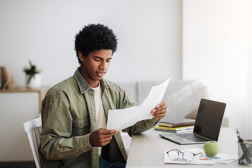 Recent college grad works remotely for an entry-level job
