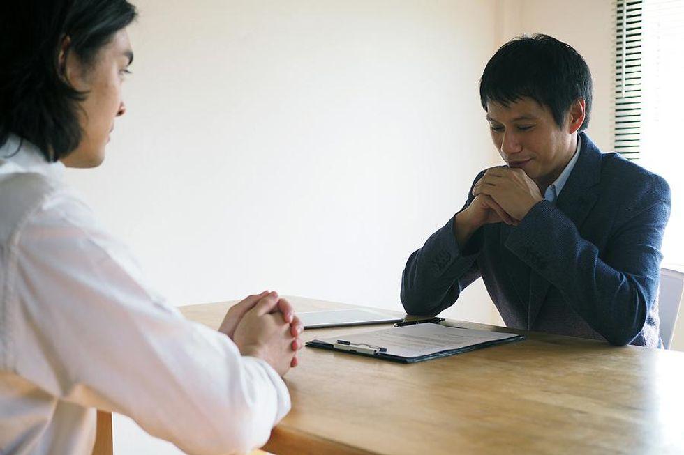 Man waits to hear if he got a job offer or not
