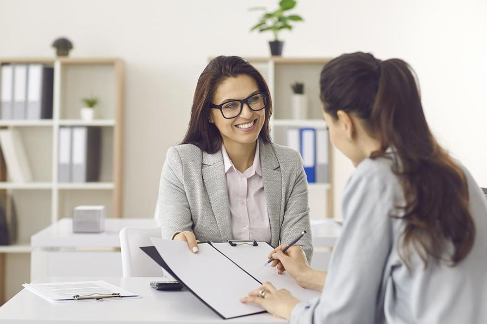 Hiring manager offers the job to a female job candidate