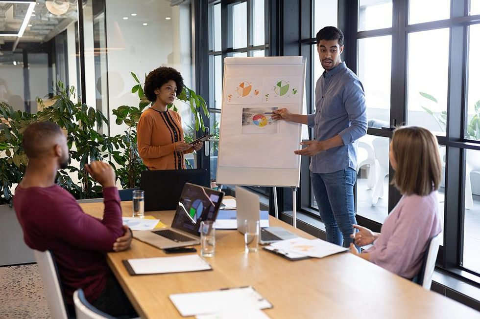 Employees go over their company's diversity data.