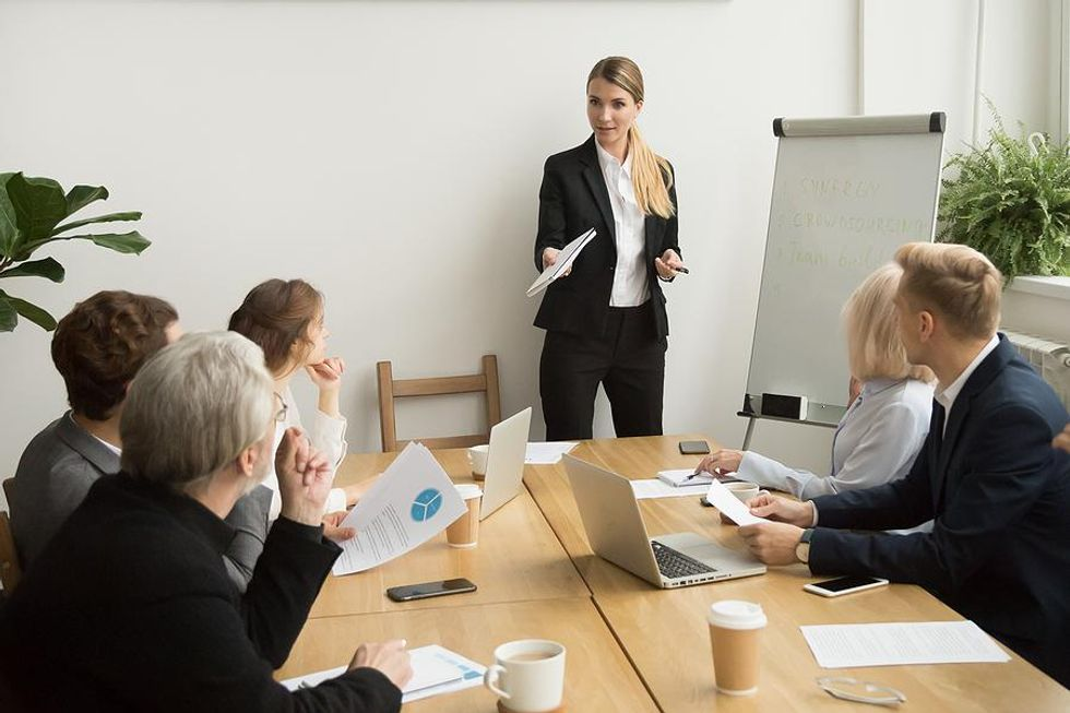 Woman leads a meeting at work