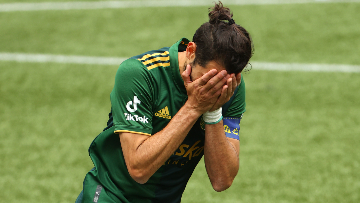 Why professional soccer players choke during penalty kicks