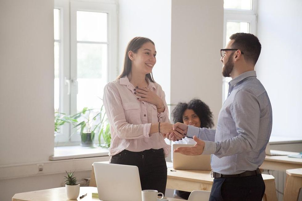 Leader motivates an employee by showing his appreciation