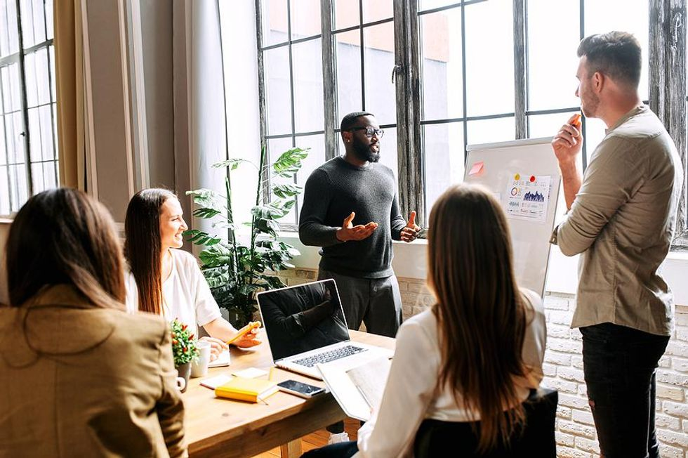 Motivated employees present an idea to their coworkers