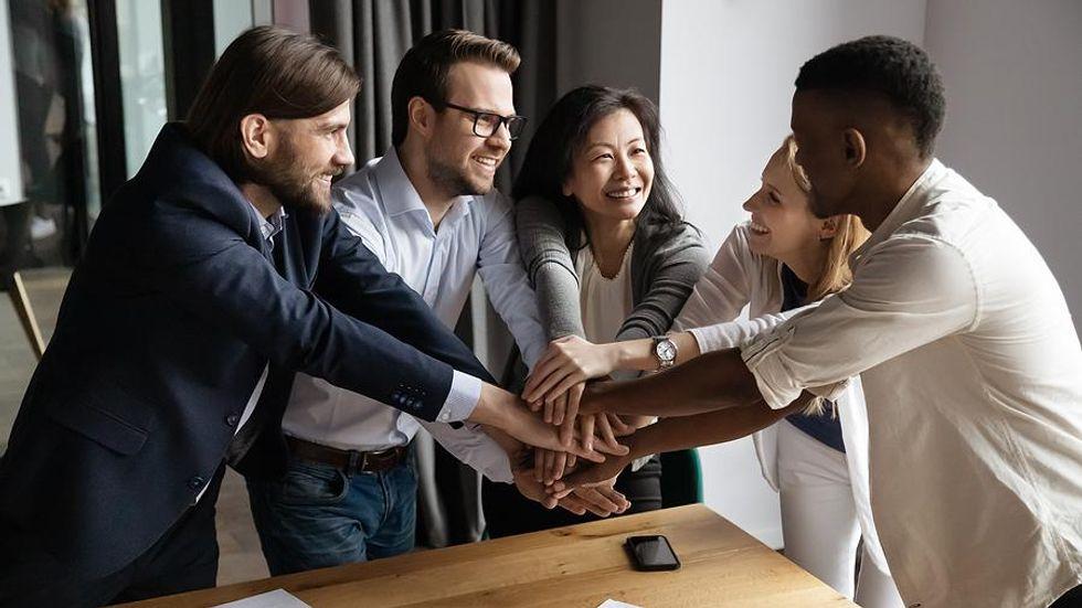 Leader motivates her team at work