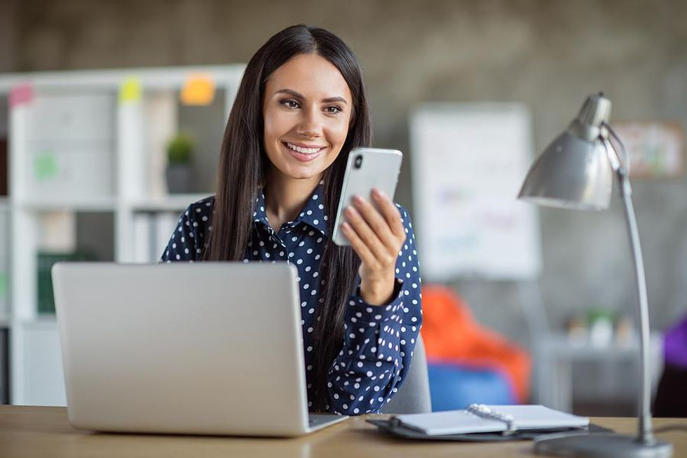 Woman accepts a new connection request from someone on LinkedIn