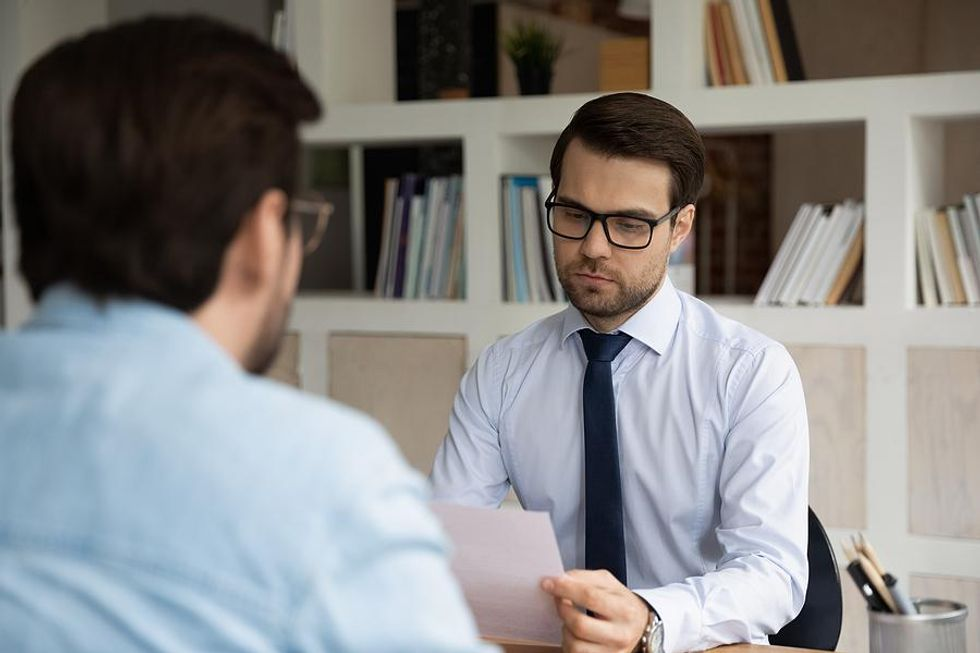 Hiring manager reviews documents from a job candidate
