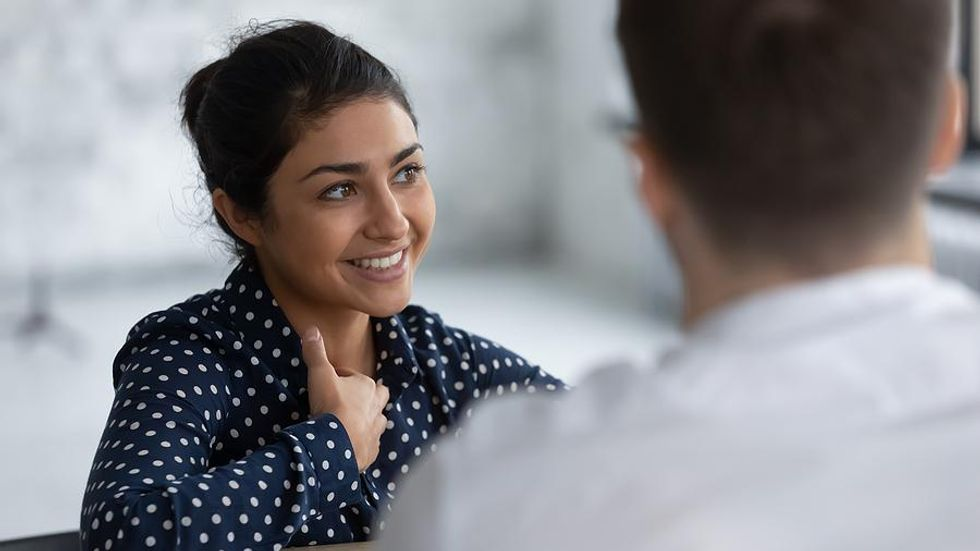 Job candidate talks to the hiring manager during an interview