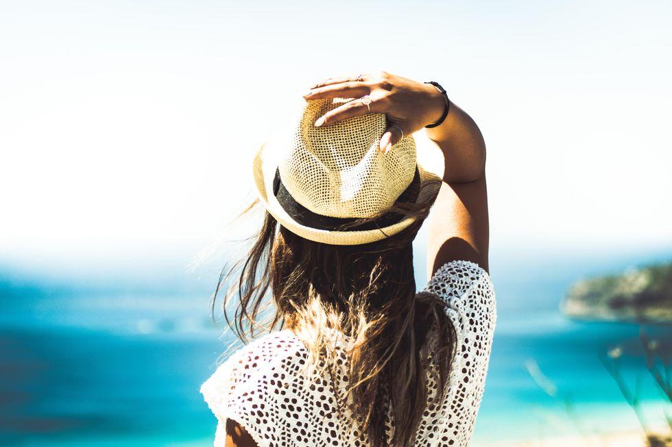 Photo of girl overlooking ocean.