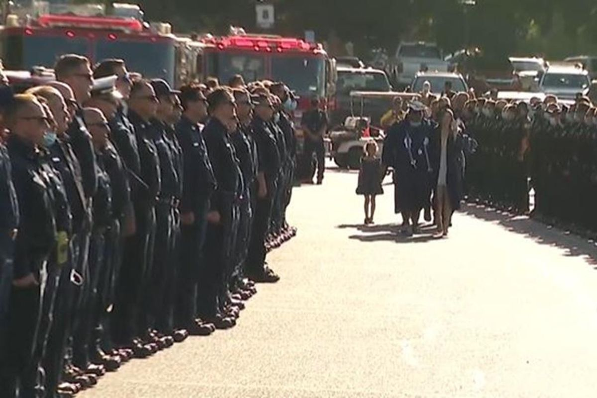 Two days after a firefighter's death, hundreds of colleagues attended his daughter's graduation