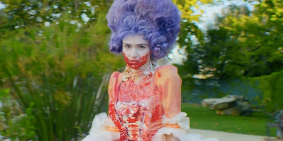"""Listen to Grimes' New Track """"laughing and not being normal"""""""