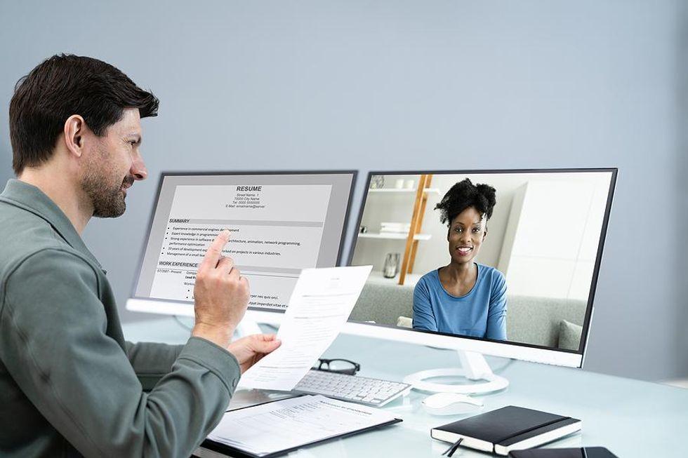 Hiring manager interviews a job candidate