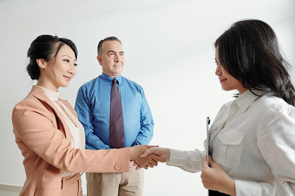 Woman shakes hands with the hiring manager