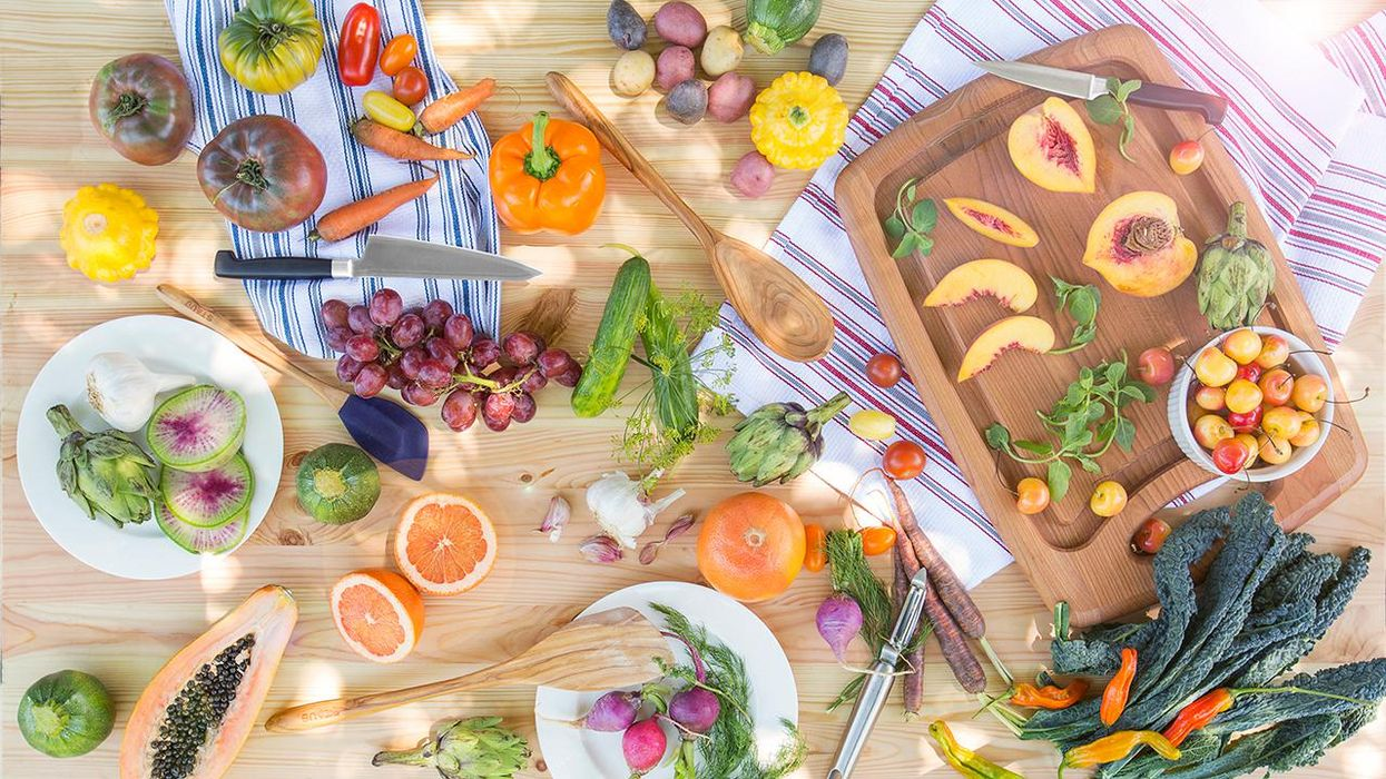 Fruit and Vegetable spread on wooden cutting board