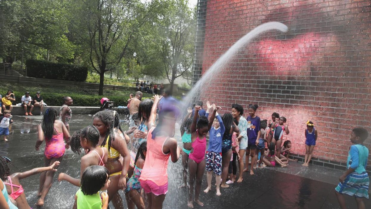 Children cool off in Crown Fountain in downtown Chicago.