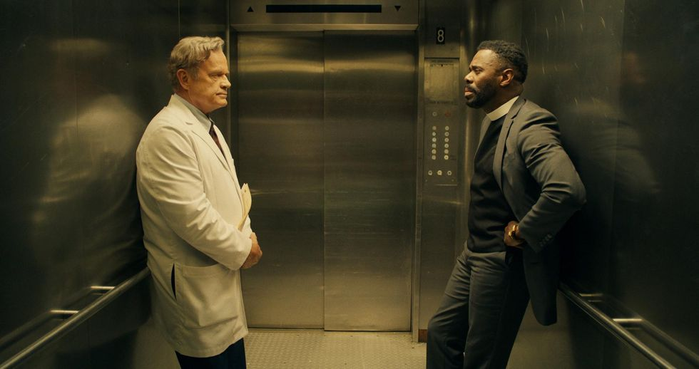 """Kelsey Grammer (left) as Dr. Andre Boxer and Colman Domingo (right) as Father Dunbar face each other while waiting for their elevator to reach their destination in """"The God Committee."""""""