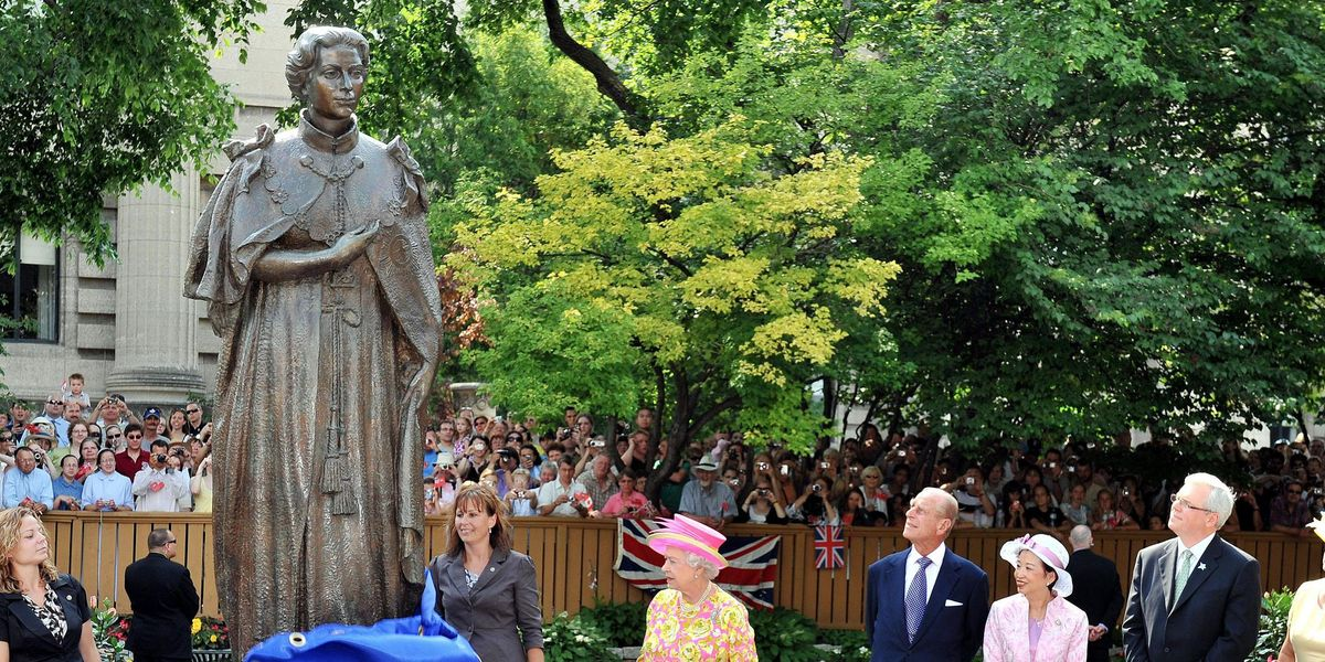 Protesters Topple Queen Elizabeth Statue After 1,000 Indigenous Children Were Discovered in Mass Graves