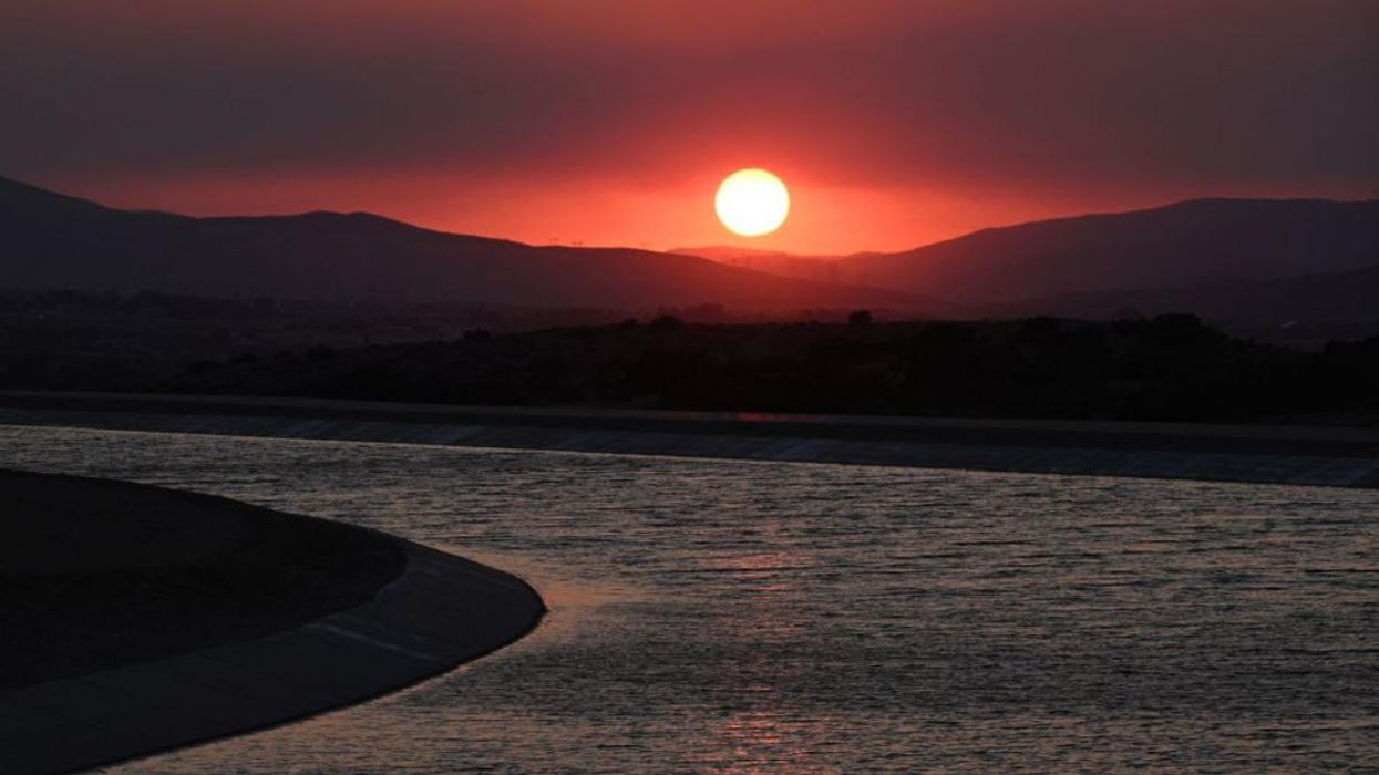 The sun sets over the California Aquedect in Palmdale, California.