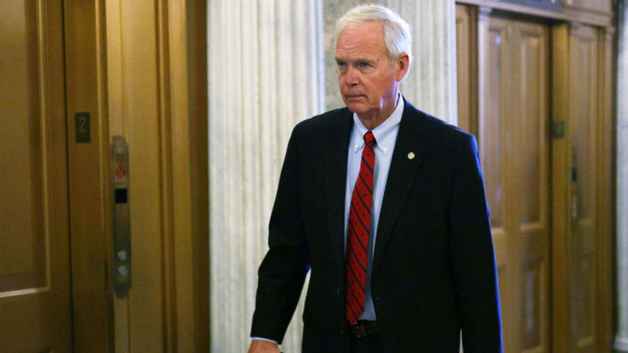 U.S. Sen. Ron Johnson arrives for a vote at the Senate chamber at the U.S. Capitol.