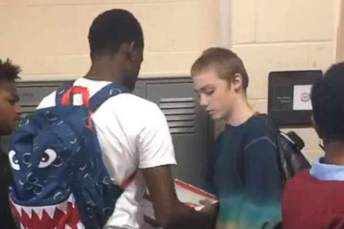 High schooler mocked for wearing the same clothes every day surprised by football players