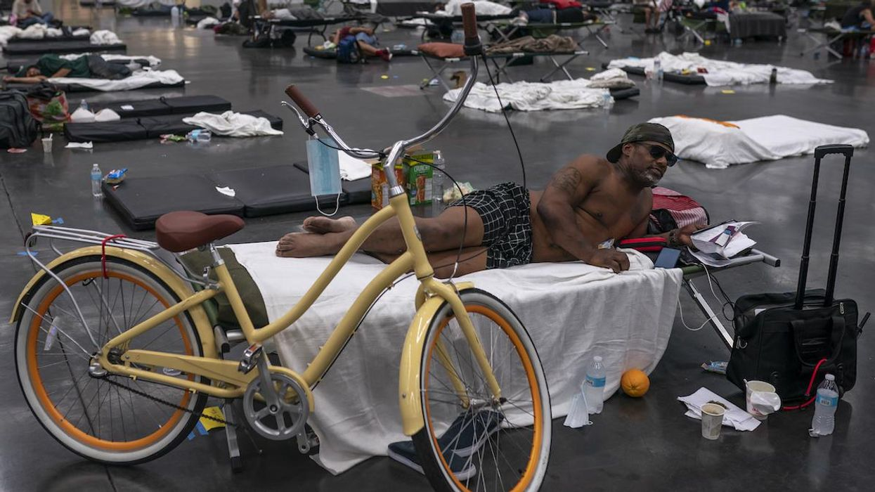 People find shelter from the heat in a cooling center at the Oregon Convention Center.
